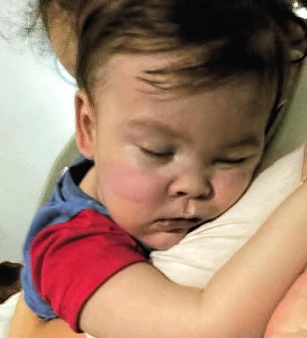 Alfie Evans nursed by his mother Kate James at Alder Hey Hospital